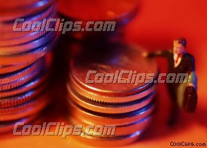 toy man leaning on stacks of coins Royalty Free Stock Photo Clipart wb026314